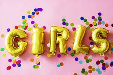 Free Gold Girls Letter Balloons On Pink Surface Stock Images - 126404514