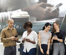 Free Three Women And One Man Looking On Smartphones Stock Images - 126404564