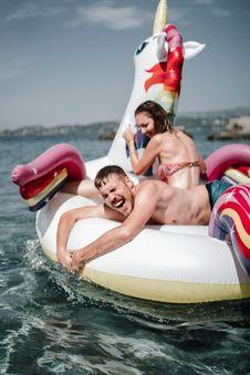 Free Couple Riding Unicorn Inflatable Floater Royalty Free Stock Photo - 126404565