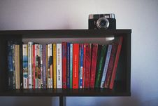 Free Black Wooden Shelf And Black Camera Stock Images - 126404694