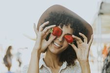 Free Woman Holding Two Strawberries Royalty Free Stock Photo - 126405045