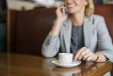 Free Woman Talking To Phone White Drinking Coffee Stock Image - 126405071