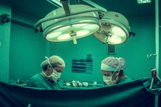 Free Two Person Doing Surgery Inside Room Royalty Free Stock Image - 126405216