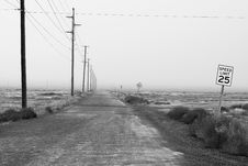 Free Monochrome Photography Of An Empty Road With Speed Limit Sign Royalty Free Stock Images - 126543699