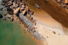 Free Bird S Eye View Of Boat Beside Boulders Stock Photo - 126543800
