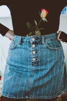 Free Woman In Black Long-sleeved Shirt And Blue Denim Skirt Stock Photography - 126543912