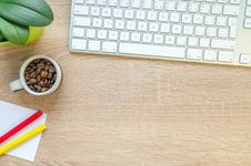 Free Silver Apple Magic Keyboard On Table Beside Of White Coffee Mug With Coffee Beans Stock Photo - 126652430