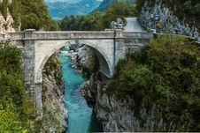 Free Concrete Bridge Over Clear Blue River Beside Mountain Royalty Free Stock Images - 126652699