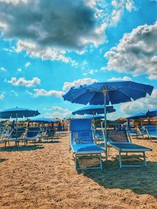 Free Blue Parasols And Sun Loungers On Sand Stock Image - 126652861
