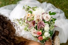 Free Top View Photography Of Bride Sitting On Grass While Holding Flower Bouquet Royalty Free Stock Image - 126652906