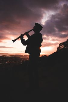Free Silhouette Photo Of Person Playing Clarinet Stock Photo - 126652960