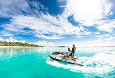 Free Two People Riding A Jet Ski Royalty Free Stock Photos - 126652988
