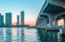 Free Body Of Water Under Bridge Near Buildings Stock Images - 126727594