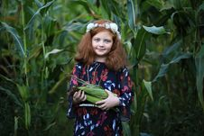 Free Girl Standing In A Cornfield Carrying Corn Stock Photography - 126727862