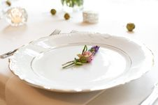 Free Close-up Photo Of Pink And Purple Flower On Scalloped Edge White Ceramic Plate Beside Silver Fork And Spoon On Table Royalty Free Stock Photography - 126727867