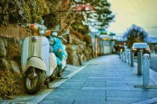 Free Two Beige And Teal Motor Scooters On Street Royalty Free Stock Photos - 126727898
