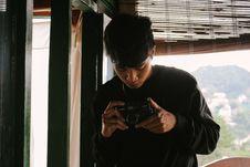 Free Close-Up Photo Of Man Holding Vintage Camera Stock Photo - 126807800