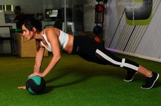 Free Woman Doing Exercise Inside Gym Stock Photography - 126808022