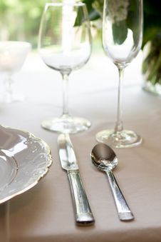 Free Silver Spoon And Knife On Table Near White Plate Stock Image - 126808031