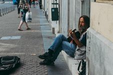 Free Man Playing Guitar While Sitting On Floor Royalty Free Stock Photography - 126808357