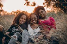 Free Three Women Sitting On Grass Stock Images - 126898274