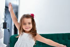 Free Smiling Girl With Raised Right Hand And Left Hand On Her Side Stock Photography - 126898432