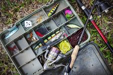Free Tackle Box With Fishing Lures And Rods Stock Image - 126980331
