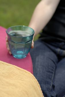 Free Female Hand Holding A Turquoise Glass Stock Images - 1270124