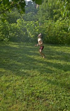 Free Boy Snatching Water In The Garden Stock Image - 1270291