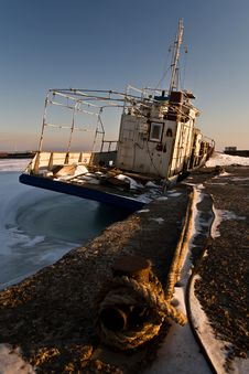 Ship In Ice At The Pier Royalty Free Stock Photo