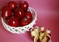 Apple In Fruit Basket With Apple Cutter Royalty Free Stock Image
