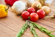 Free Red Tomatoes Near Rosemary And Other Spices Close-up Photography Royalty Free Stock Image - 127260026