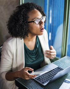 Free Woman Sitting On Chair While Using Laptop Computer Stock Photos - 127260093