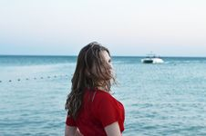 Free Woman Standing In Front Of Body Of Water Stock Image - 127260371