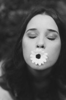 Free Grayscale Selective Focus Photography Of Woman With Flower In Her Mouth Stock Images - 127260494