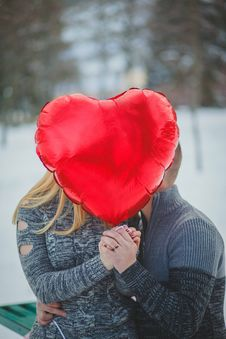 Free Couple Holding Hands With Red Heart Balloon Stock Photo - 127260710
