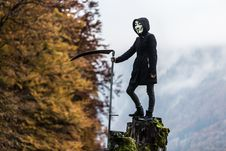 Free Photo Of Person Wearing Guy Fawkes Mask While Holding Scythe Stock Photography - 127260742