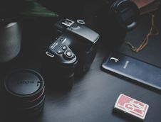 Free Dslr Camera Beside Samsung Smartphone On Black Surface Stock Photo - 127315020