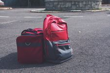 Free Red And Gray Backpack Beside Red Duffel Bag Royalty Free Stock Photography - 127449957