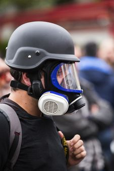 Free Man Wearing Black Gas Mask And Protective Helmet Stock Image - 127450001
