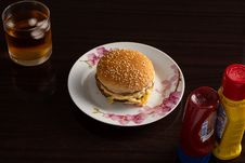 Free Hamburger On White And Pink Floral Plate Stock Photography - 127450022