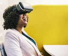 Free Laughing Woman Using Black Virtual Reality Headset Stock Images - 127450064