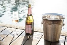 Free Champagne Bottle Near Champagne Glass And Gray Bucket Stock Images - 127450074