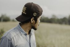 Free Selective Focus Of Man Wearing Brown Cap Royalty Free Stock Photography - 127450237