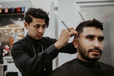 Free Man Cutting Another Man S Hair Stock Image - 127552201