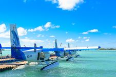 Free Three Blue-and-white Amphibious Planes Royalty Free Stock Photography - 127649957