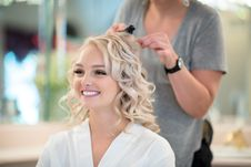 Free Smiling Woman Getting Hair Curled By Another Woman Royalty Free Stock Photo - 127650365