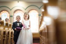 Free Boy And Girl Walking Down The Aisle Stock Images - 127767314