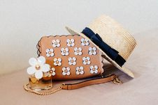 Free Brown Sun Hat On Brown And White Floral Sling Bag Royalty Free Stock Images - 127767359