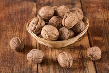Free Walnuts In Retro Bowl And Spilled On Wooden Desk Stock Images - 127843404